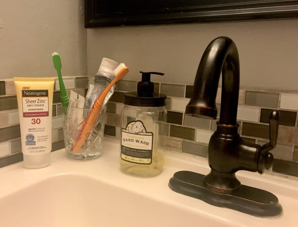 sunscreen next to toothpaste