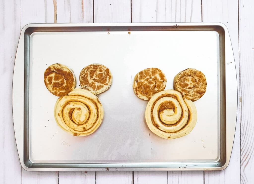 giant mickey cinnamon rolls made with 1 grande cinnamon roll and 2 regular cinnamon rolls