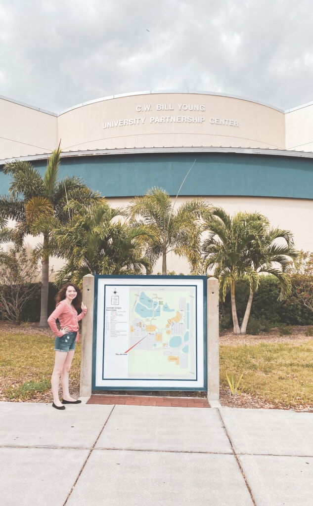 girl in front of campus campus map for florida prepaid