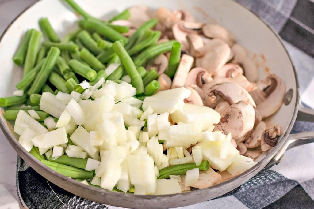 suauteed green beans onions and mushrooms