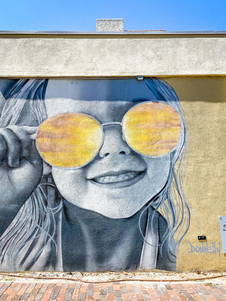 little girl in sunglasses mural downtown st. pete florida