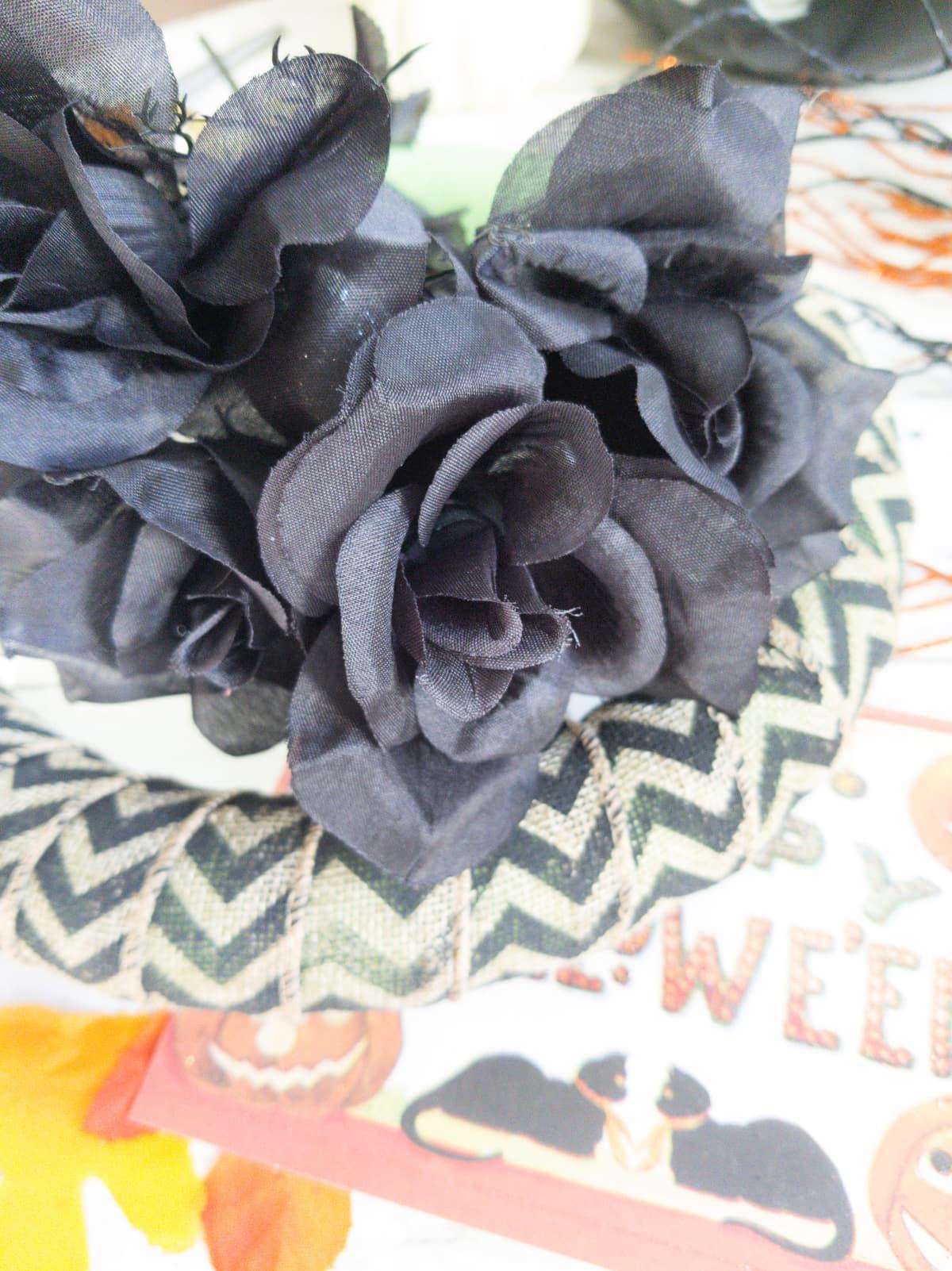Black silk flowers on wreath