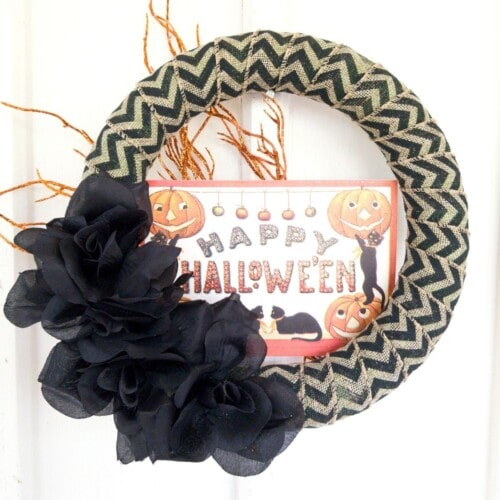 Happy Halloween wreath on white wall