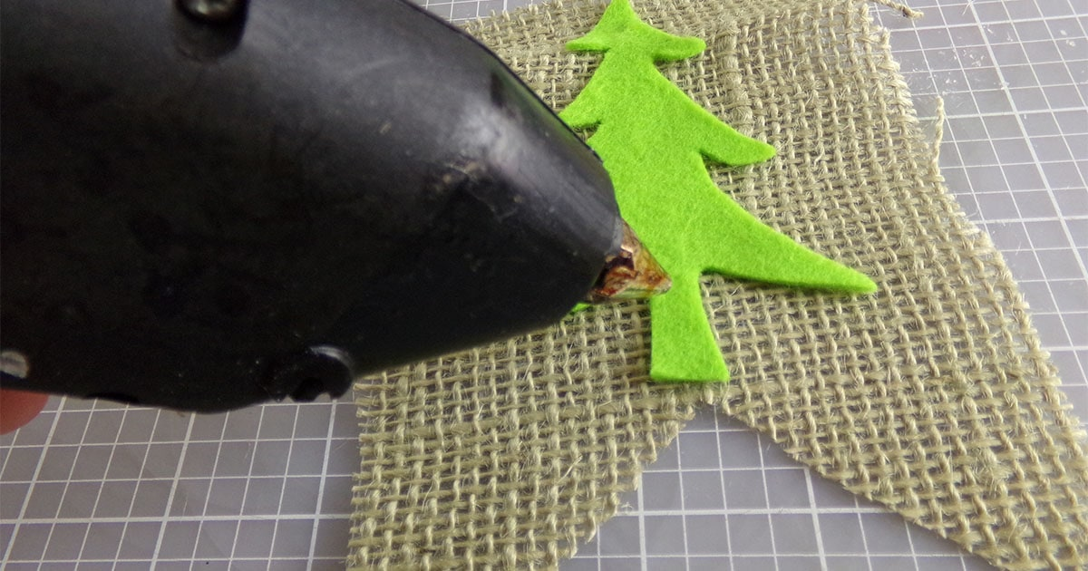 in-process step of gluing the parts on to make a christmas farm truck garland