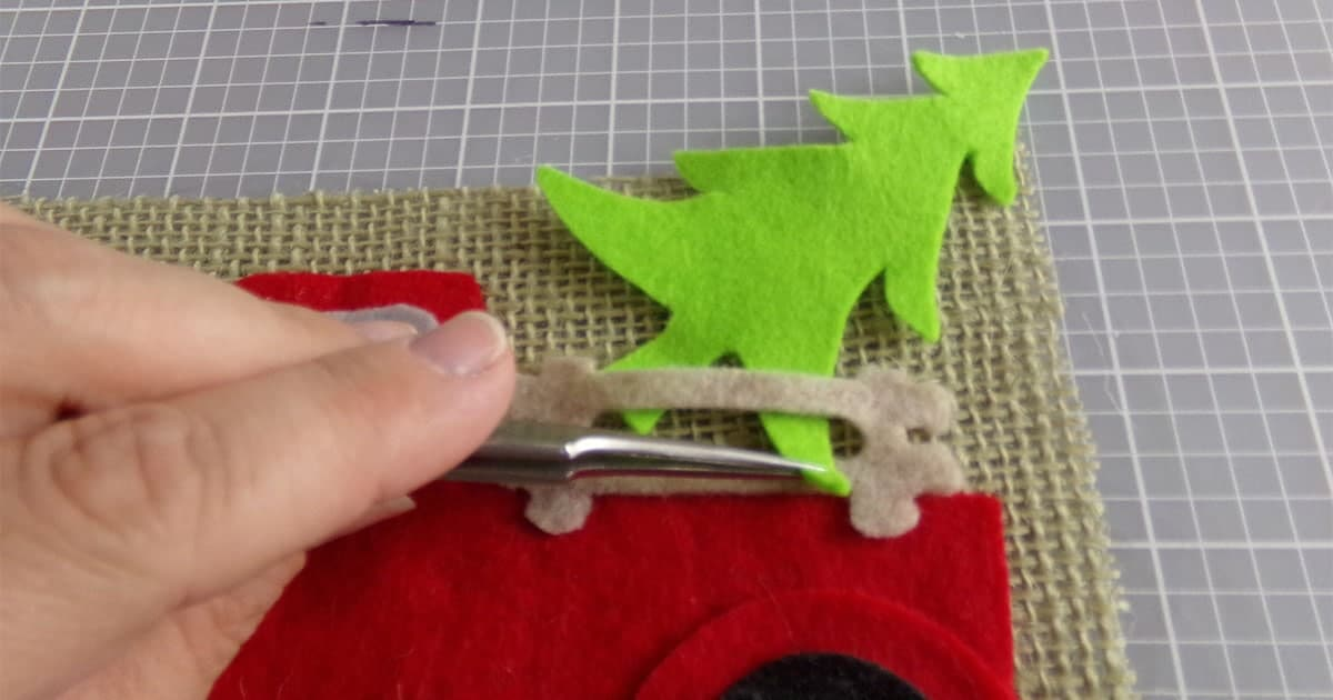 in-process step of assembling christmas farm truck garland cricut craft