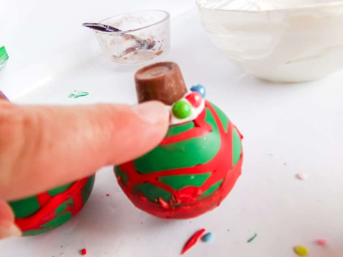 in-process step of decorating Christmas Ornament Hot cocoa bombs