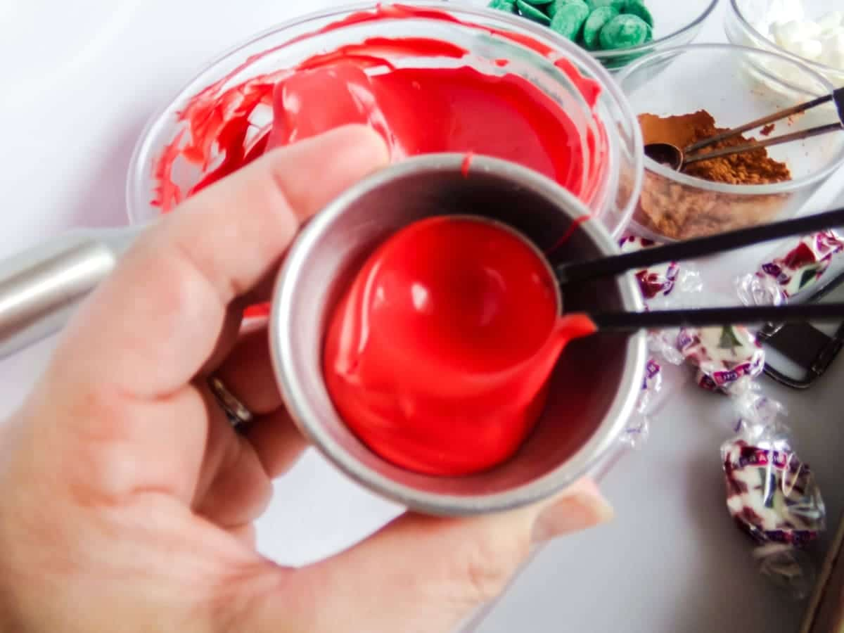 in-process step of filling molds to make Christmas Taffy Hot Cocoa Bombs