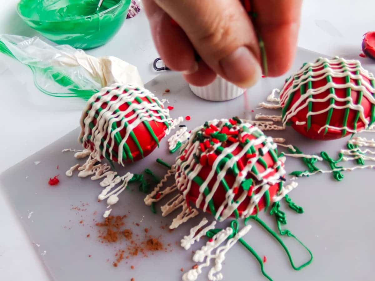 in-process step of decorating Christmas Taffy Hot Cocoa Bombs