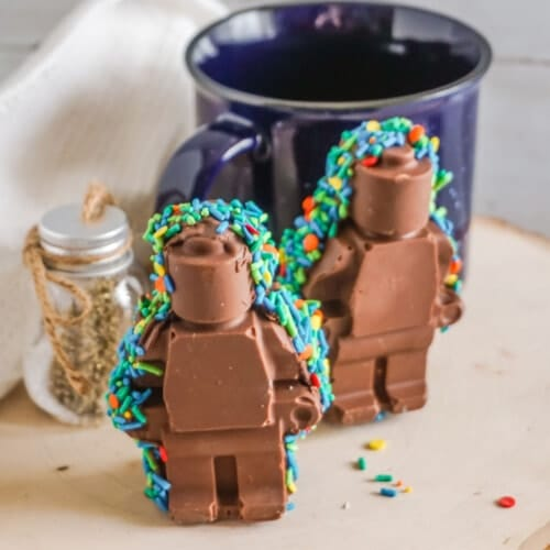 two 3D Lego Man Hot Cocoa Bombs