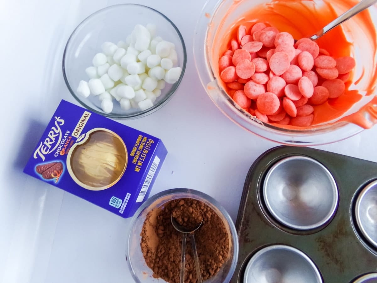 supplies to make Orange Slice Candy Hot Cocoa Bombs