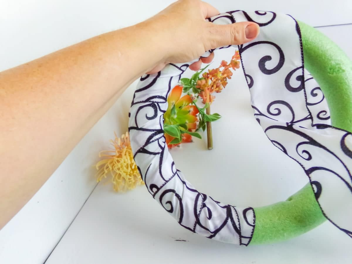 wrapping ribbon around a wreath form to make a succulent wreath