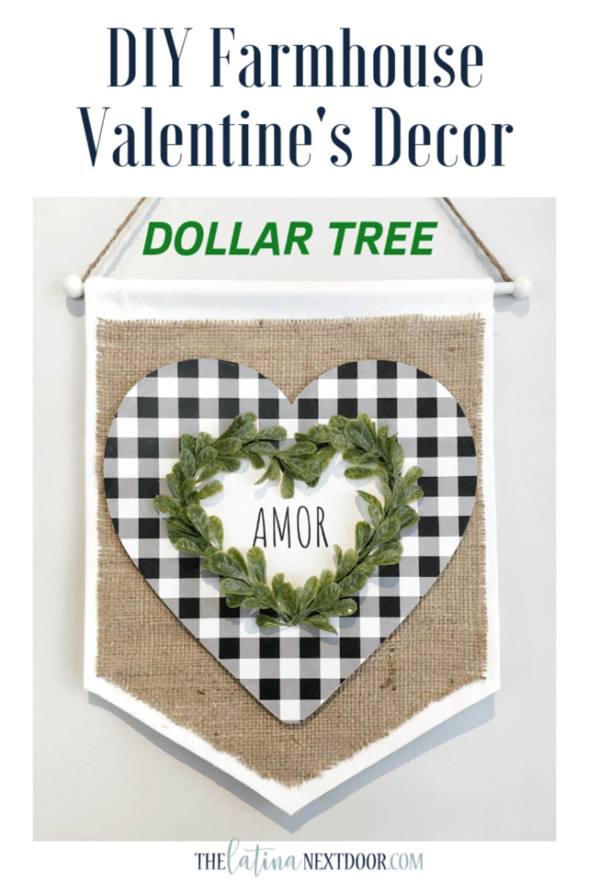 "UNder the text DIY Farmhouse Valentine's Decor Dollar Tree, sits a burlap pennant with a white frame. On top of teh burlap is a heart in black and white check On top of that is a heart in foliage and the word ""Amor"" inside."