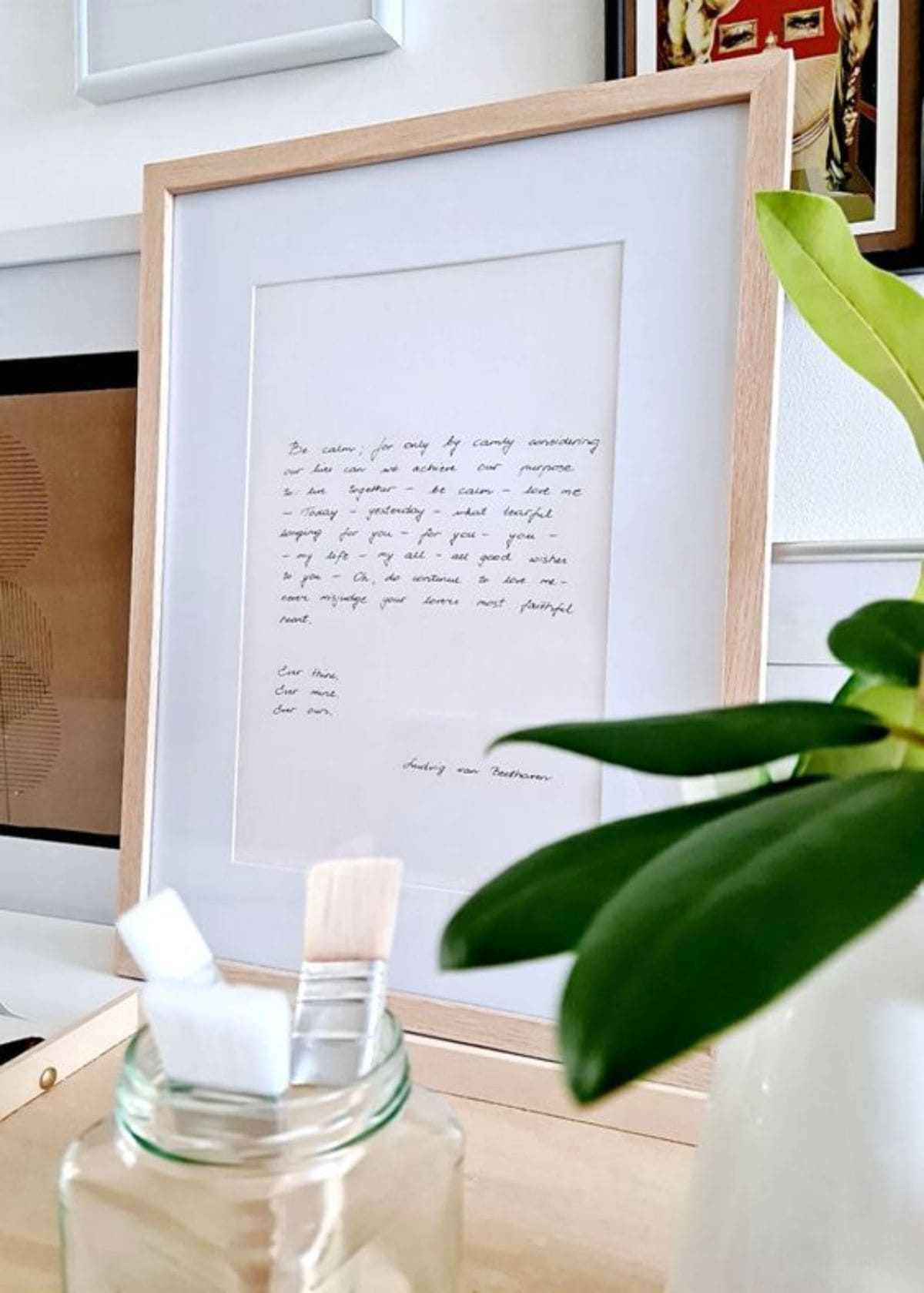 a framed love letter sits on a table