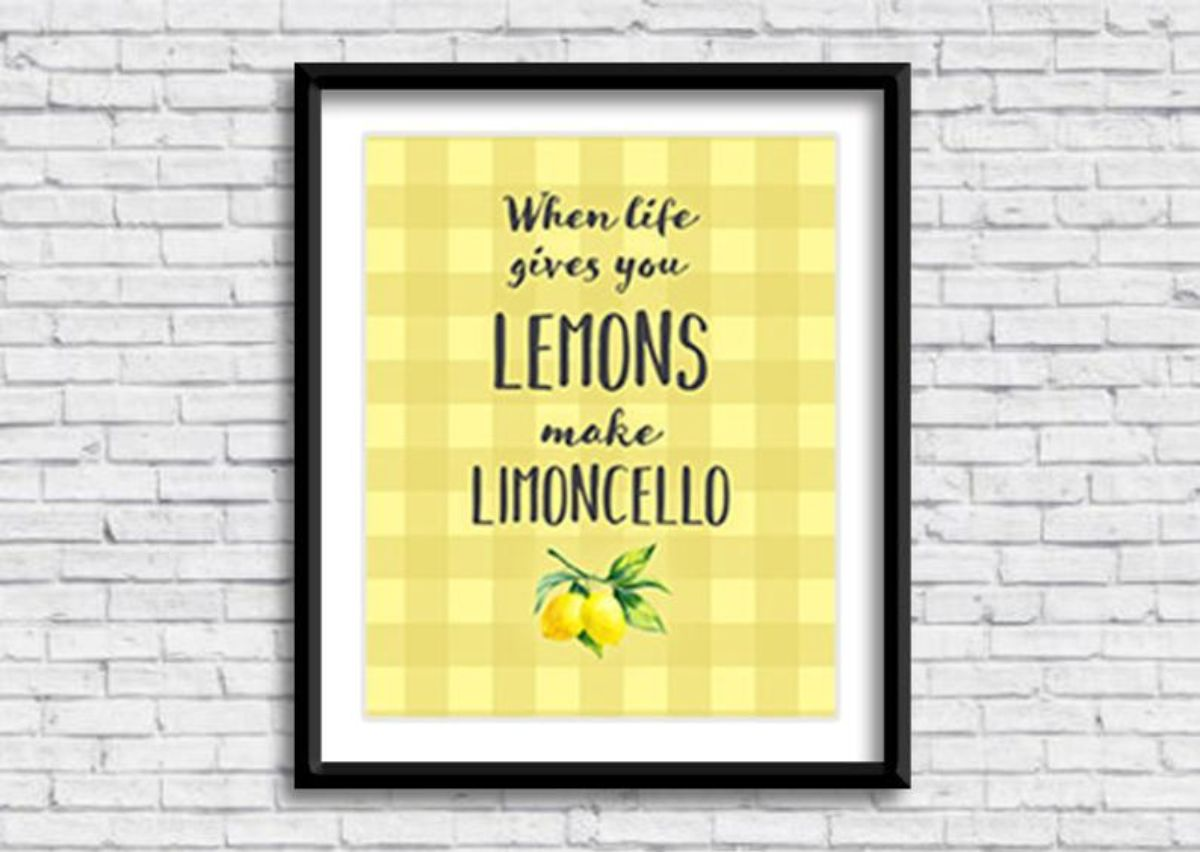 """On a white brick background is a black frame with a yellow picture. The words in black are """"When life gives you lemons make limoncello"""""""