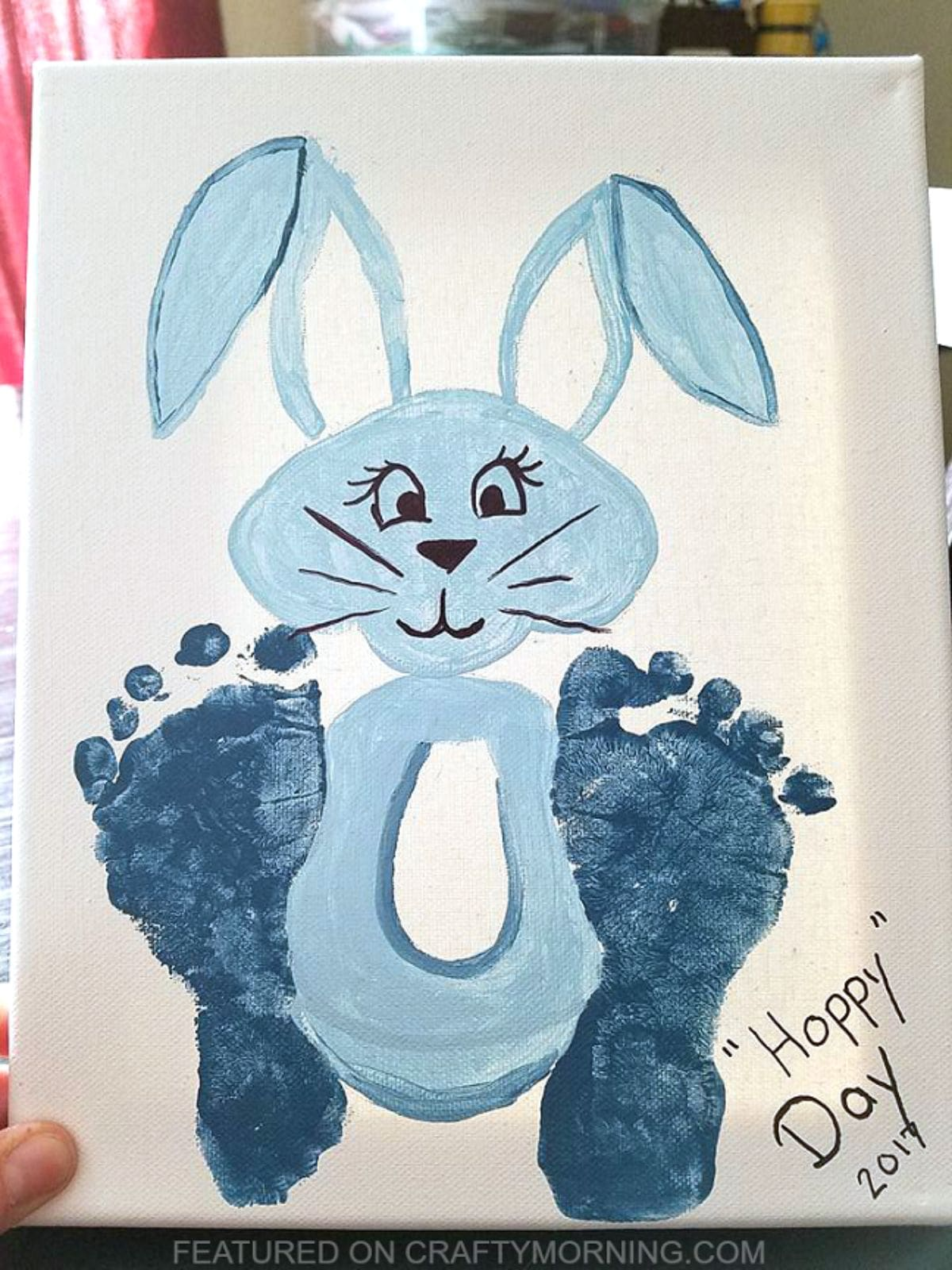 A blue bunny picture with baby footprints as its feet