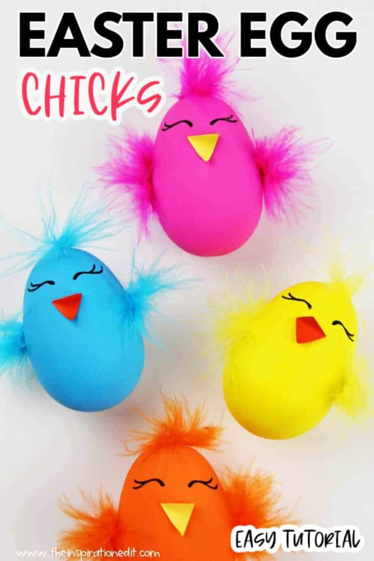 four colored eggs turned into chicks with craft feathers
