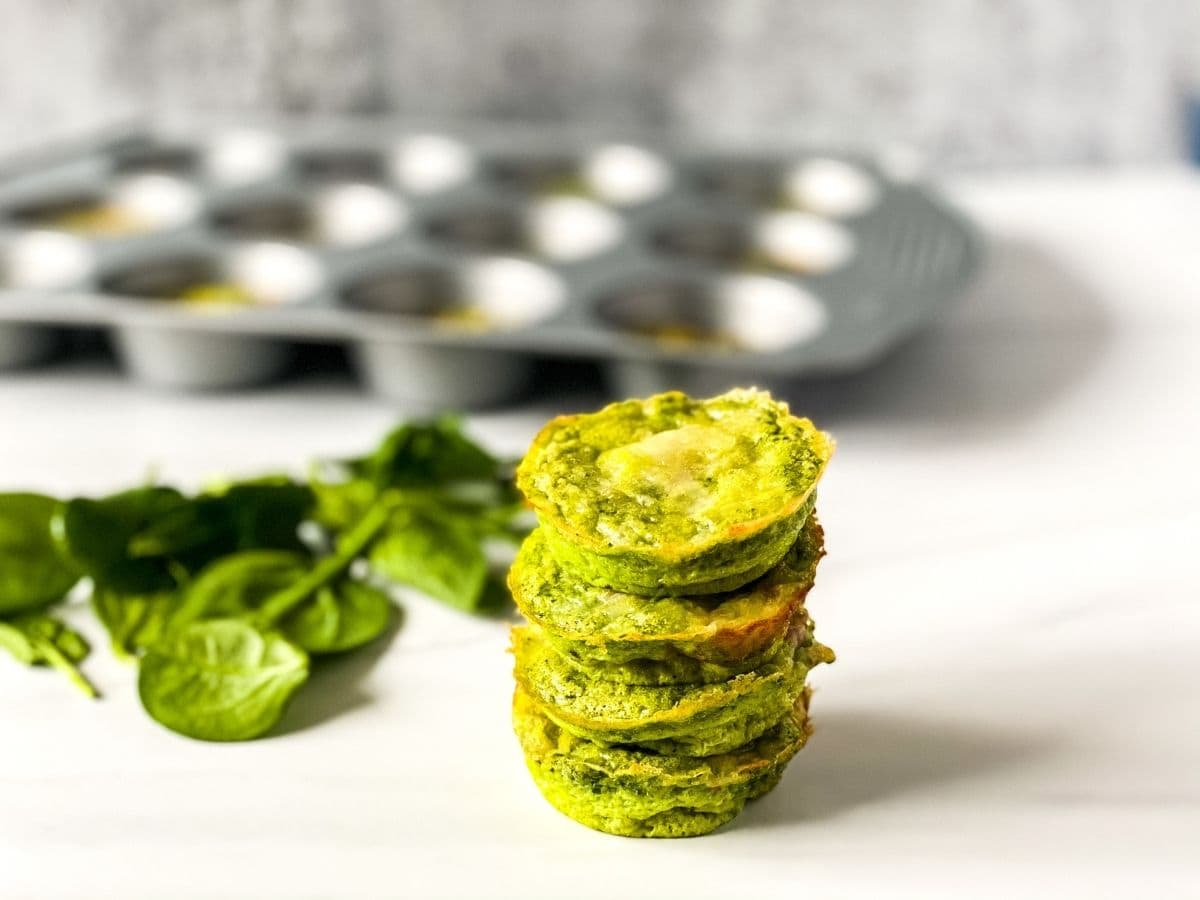 Stack of green eggs and ham muffins