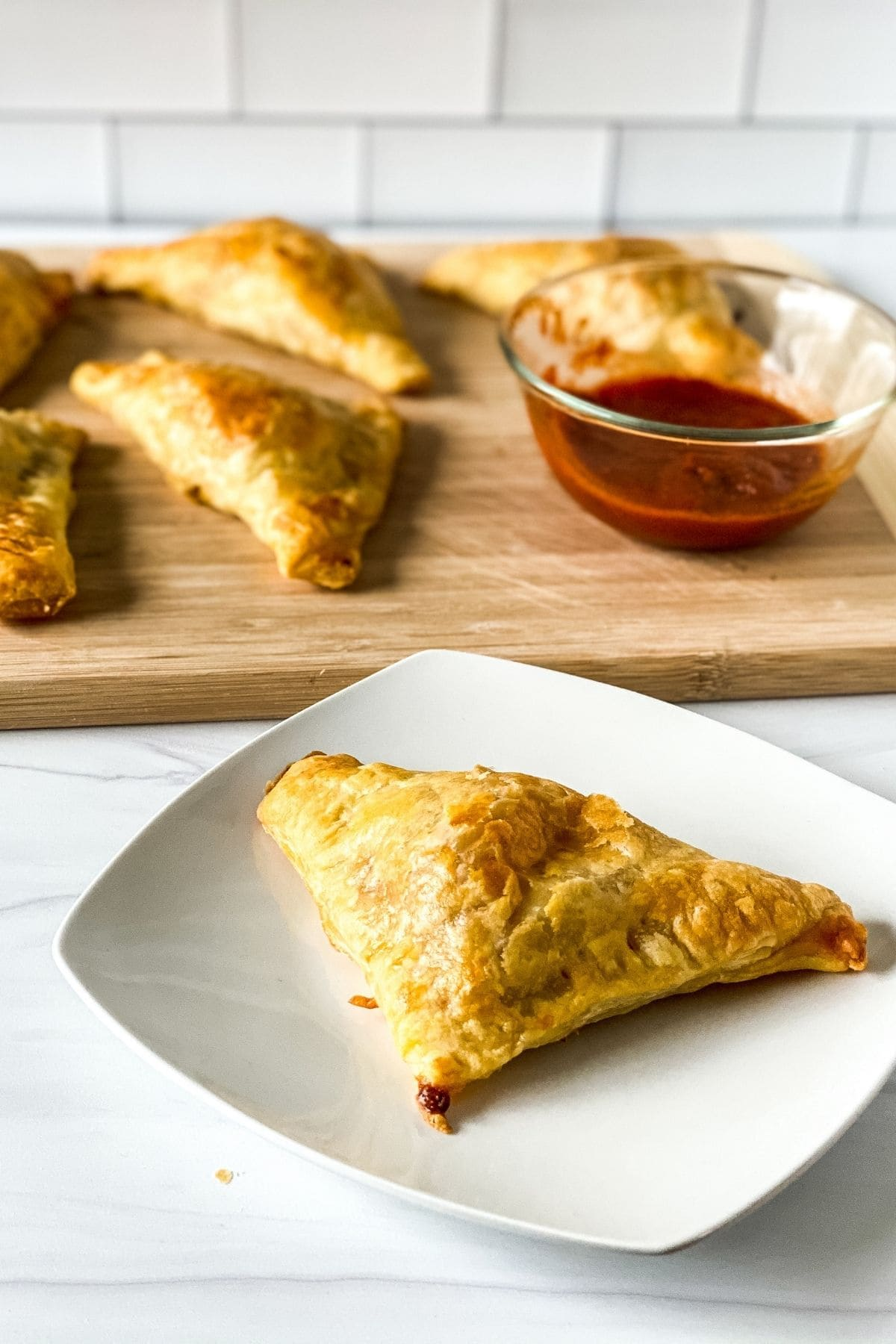Puff pastry pizza snack on plate