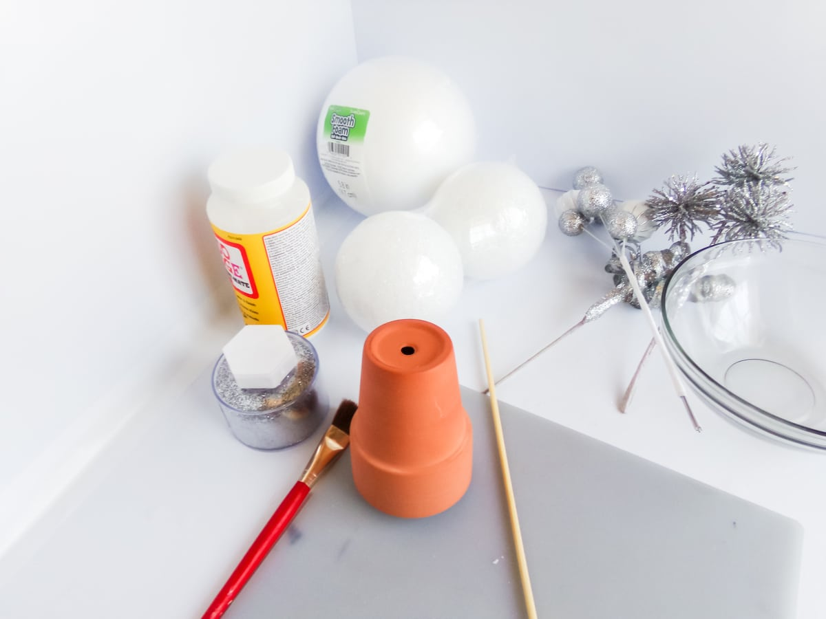 supplies to make a mickey holiday topiary craft